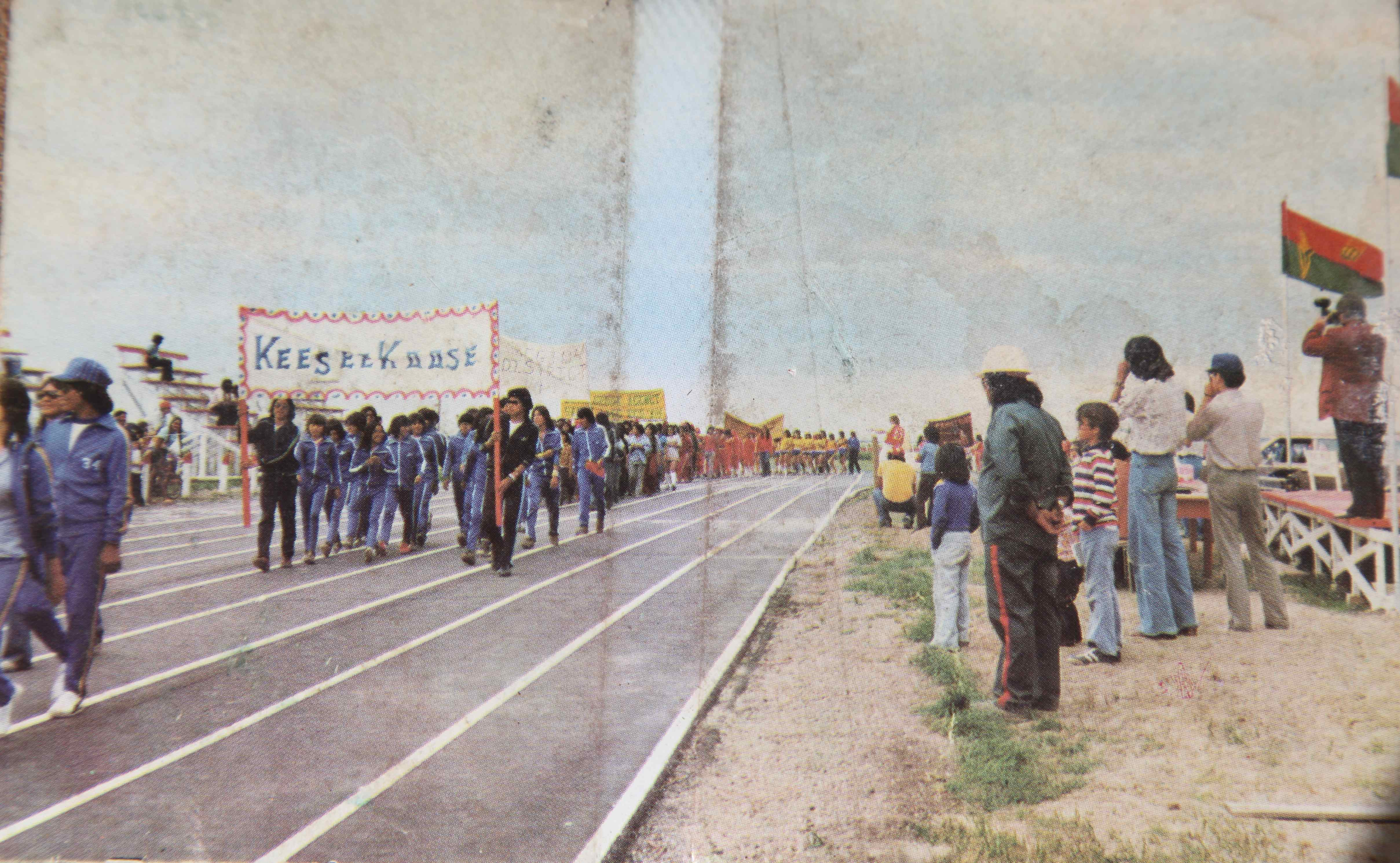 Keeseekoose Reserve Youth march past the reviewing stand at the Saskatchewan Indian Summer Games, Cote Reserve, 1977